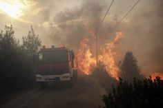 Flames are seen next to firefighting vehicle during a forest fire in Neo Voutsa, a northeast suburb of Athens, Greece, 23 July 2018 Costa, Strong Wind, Image Caption, Acropolis, The Other Side, Greece Travel, Small Towns, Picture Video, Athens Greece