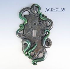 This deluxe steampunk light switchplate was hand sculpted and painted over a standard wide style switch wall plate. The octopus tentacles have been