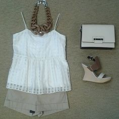 Leona Lilly top in ivory, Bcbg Symon short in khaki, Pella Moda Burlywood tri-tone wedge, Bcbg Leighton bag, and Zenzii resin link necklace.