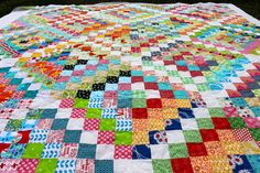 Loops and swirls on a scrappy trip around the world quilt.