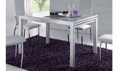 Mesa de comedor extensible con cristal en blanco y estructura metálica.