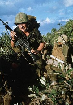 U.S. Marines pinned down in a firefight, May Gio Linh, Quang Tri Province.  ~ Vietnam War