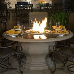 The Inverted Dining Height Fire Table, Concrete Top by American Fyre Designs provides a high end gas fire pit table that can be customized to perfectly suit your needs. This unit features a glass fiber reinforced concrete construction to ensure a long las Outdoor Fire Pit Table, Gas Fire Pit Table, Fire Pit Backyard, Outdoor Living, Outdoor Decor, Oasis Backyard, Outdoor Tables, Fire Pit Ring, Fire Pits