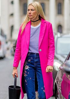 Love the pink long coat with the embroidered jeans, the bucket purse is great, too.