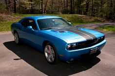 Challenger, my dream car but with yellow accents on the inside and all baby blue on the outside. Someday i will pay for this with my own money.