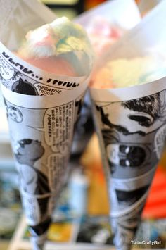 Comic book pages printed out & rolled into cones for cotton candy. Genius!