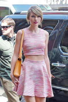 No one wears a crop top like Taylor Swift—here are 30 times slayed the summer trend