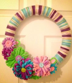 Spring Yarn Wreath adorned with Colorful Felt Flowers and Buttons on Etsy, $30.00
