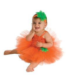 Orange Pumpkin Tutu Dress Set - Infant | The tiniest ballerinas can twirl through the afternoon in vivid, frilly style with this sheer, flowing tutu ensemble. A stretchy elastic waist keeps this dress-up sensation perfectly in place for playroom dance recitals, while an included diaper cover keeps little derrieres from making unscheduled appearances.  - Includes headband, dress and diaper cover. 100% polyester exclusive of trim. Hand wash; hang dry. {6-9mos}