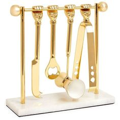 Jonathan Adler Five-Piece Macho Mantiques Barbell Brass Barware Set ($198) ❤ liked on Polyvore featuring home, kitchen & dining, bar tools, brass ice tongs, 5 piece bar set, jonathan adler, brass bottle opener and brass bar set