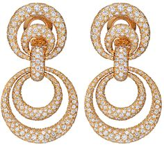 Van Cleef & Arpels Gold & Diamond Double Circle Drop Earrings.  Double open circle, two-drop earrings, pavé-set with circular-cut diamonds, mounted in 18k yellow gold, with French assay marks, numbered 20879, signed Van Cleef & Arpels. Via 1stdibs.