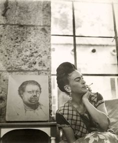 Frida Kahlo with 1930 Self-Portrait drawing by Diego Rivera, Coyoacan, circa 1945. Vicente Wolf Photography Collection Lola Alvarez Bravo