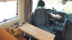 Slick marine-style folding front table in Peter's Mercedes Sprinter camper conversion, a CS Rondo.