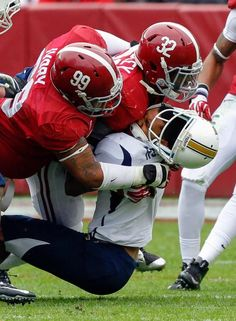 Alabama defensive lineman Brandon Ivory (99) and linebacker C.J. Mosley (32) tackle Chattanooga quarterback Terrell Robinson (6) knocking his helmet. (Butch Dill/AP)