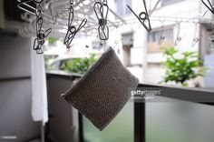 A sponge and a towel dry on the balcony of the minimalist Fumio Sasakis appartment in Tokyo, Japan, on June 24, 2016. Fumio Sasaki, 36, Editor, decided to live less cluttered with useless personal and domestic possessions 8 years ago after meeting with a minimalist family who live in Croatia, because he became tired of keeping up with trend. This philosophy 'Minimalism' has become famous in recent years in Japan especially between young people who want nothing to do with acquiring material…
