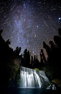 Orionids meteor shower over McCloud Falls, Shasta-Trinity National Forest, Calif. (© Brad Goldpaint/Getty Images)