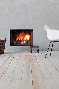 Concrete fireplace & wooden floor