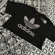 ✨last one! black adidas custom crop top✨ New custom Adidas crop top  Adidas authentic  Color: Black with gray Adidas logo  Premium quality   ❎No trades ❎Price firm   tags: shopcapri, adidas, adidas originals, yeezy, crop top, kanye west, kylie jenner, crop, top, black, white, shirt, the weeknd, abel, drake, hotline bling, pink Adidas Tops Tees - Short Sleeve