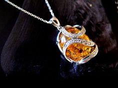 18K white gold diamonds. amber.
