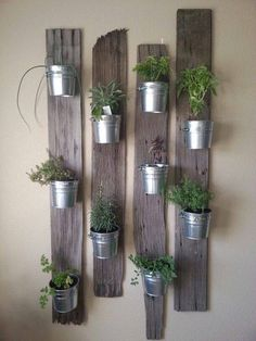 Reclaimed wood boards and metal pots make beautiful vertical planters. Re-scape.com