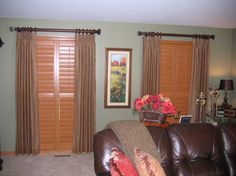 Stained wood shutters adds a rich look with drapery panels to soften it up. Indoor Shutters, Wood Shutters, Bow Window Treatments, Drapery Panels, Blinds, Windows, Curtains, Home Decor, Decoration Home