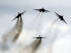 MiG-29 jets from the Russian aerobatic group Strizhi perform during the MAKS-2015 International Aviation and Space Show in Zhukovsky, outside Moscow.  Pavel Golovkin, AP