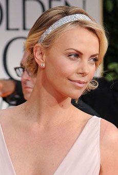 love her sparkling accessory. Charlize Theron at the 2012 Golden Globes #weddings #hairstyles
