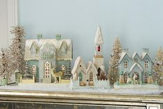 Putz houses!..Thank you my 'Cupcake Girl'...Love this idea! I should display my Putz houses more...**LOVE**