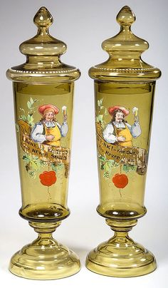 Pair of Bohemian amber glass jars/vases with  covers finely decorated in polychrome-enamel featuring a beer master raising a glass above a banner overpainted with an inscription with a dropped seal below poss. by Theodor Witzka