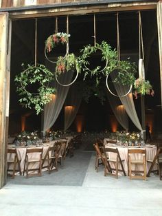 Wine barrel floral hoops that our florist created for the entrance to our barn wedding. Bohemian #BohemianWeddings