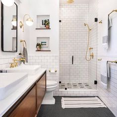 low-key luxe bathroom - The master bathroom addition in this Spanish-style home features a black-and-white color pale -