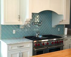 Vapor Arabesque Glass Tile Kitchen Backsplash.  https://www.subwaytileoutlet.com/products/Vapor-Arabesque-Glass-Tile.html#.VvBrYuIrLIU