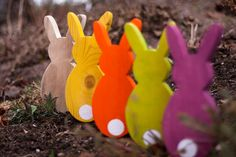 Holz-Hasen, verschieden bunt lasiert // wooden bunny decoration, available in various colors via DaWanda.com