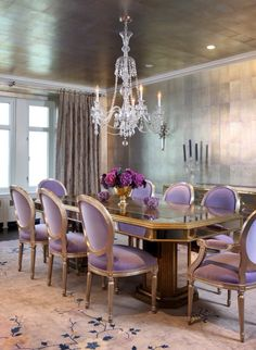 Elegant Dining room: the walls and ceiling have been treated the same rustic gold color, carpet on the floor adds the lush feel, table top has gloss finishing for the