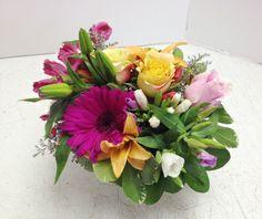 Love those cubes! Designed by Tina Ashburn, Roadrunner Florist Basket Express, Phoenix, AZ