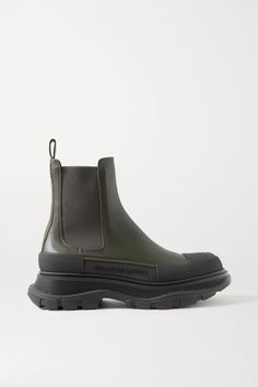 Alexander McQueen's Chelsea boots are a practical choice whether you're in the city or exploring the countryside. They've been crafted in Italy from leather that only gets better with wear, and rest on trademark exaggerated rubber soles. Tabs at the back ensure they are easy to pull on, too. Shoes Boots Ankle, Shoes Sandals, Alexander Mcqueen Boots, Alexander Macqueen, Green Leather, Army Green, Rubber Rain Boots, All Black Sneakers, Chelsea Boots