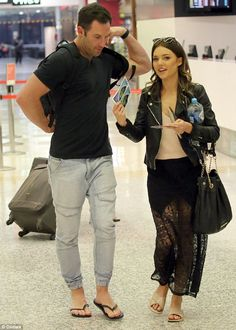 Loved up: Sam Frost recycled her favourite black lacy and racy outfit to accompany her beau Sasha Mielczarek at Melbourne Airport on Sunday