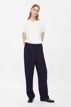 Oversized, these tailored trousers are made with soft pleats and a tapered leg for a loose, rounded shape. Designed to sit on the waist and dropped at the crotch, they have slanted front pockets, a classic zip fly fastening and a single velt back pocket.