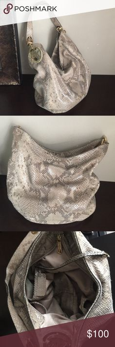 Michael Kors snakeskin print . Michael Kors snakeskin print with ivory detail on handles. Great bag gently used a bit dirty on inside will come out with wash. Dirt from pen and coins. Michael Kors Bags Shoulder Bags