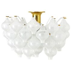 Chandelier by J.T. Kalmar Tulipan Austria 50s   From a unique collection of antique and modern chandeliers and pendants  at https://www.1stdibs.com/furniture/lighting/chandeliers-pendant-lights/