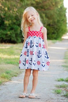 Ahoy mateys! This nautical dress is the perfect addition to any little sailors' wardrobe. With a red, white and blue color scheme, this girl's anchor dress is patriotic, playful and perfect for a wide variety of summer and spring events. Whether you are looking for a girl's sundress for family photos, a back to school dress, or a girl's sundress perfect for Fourth of July celebrations this nautical number will be an instant hit!  #waverlywadedesigns