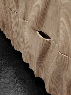 Great set of file cabinets CNC cut from laminated wood. Laminations in the wood create topographical lines because the laminate is parallel to the cut plane.