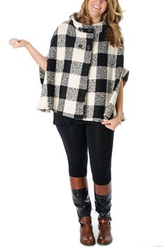 Finished with button closure at the neckline, a hood and slit arm openings, this plaid poncho looks lovely layered over a black sheath dress.