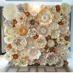 This gorgeous backdrop is made of handcrafted paper flowers. These are custom pieces, made in the colors of your choice. The one pictured is a custom 8x10 piece I made for a wedding I am doing. The flowers are made from high quality cardstock paper and heavy glue to ensure they last a very long time. The flowers will vary in sizes and will be shipped to you in a large box. You will then arrange and glue them to your own board or wall. The flowers come with backs that have hooks for hanging…