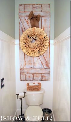 barn door or shutter with book wreath