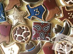 Western themed birthday party cookies - Texas, bandana, cowboy boots, sheriff star, cowboy hat, cow print cookies   Http://www.facebook.com/TinyKitchenCakery