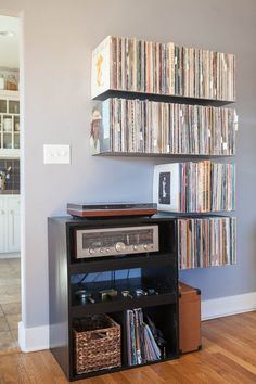 Custom metal floating record shelves. SUPER WANT.