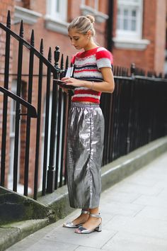 Because metallic pants look best with fuzzy sweaters. #refinery29 http://www.refinery29.com/2015/09/94443/london-fashion-week-spring-2016-street-style-pictures#slide-27