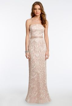 As a mother of the bride, your look needs to be one that will always be remembered. This all over soutache strapless gown from Camille La Vie is sure you make your daughter's wedding an extra-special and memorable moment. This sleek and elegant dress has a strapless neckline, a beaded empire waist and corset tieback. Complete this beautiful look with a gorgeous box handbag, a pair of low heel sandals, and earrings.  •Allover soutache dress •Strapless neckline •Beaded empire waist •Corset…