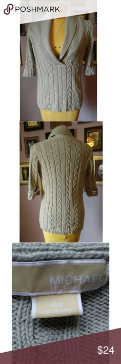 Michael Kors Cable Knit Sweater This is a used Michael Kors sweater that is in great condition. It is gray in color, has 3/4 Sleeves and a large collar with a v-neck. Dress it up or down, toure good to go either way. Michael Kors Sweaters V-Necks
